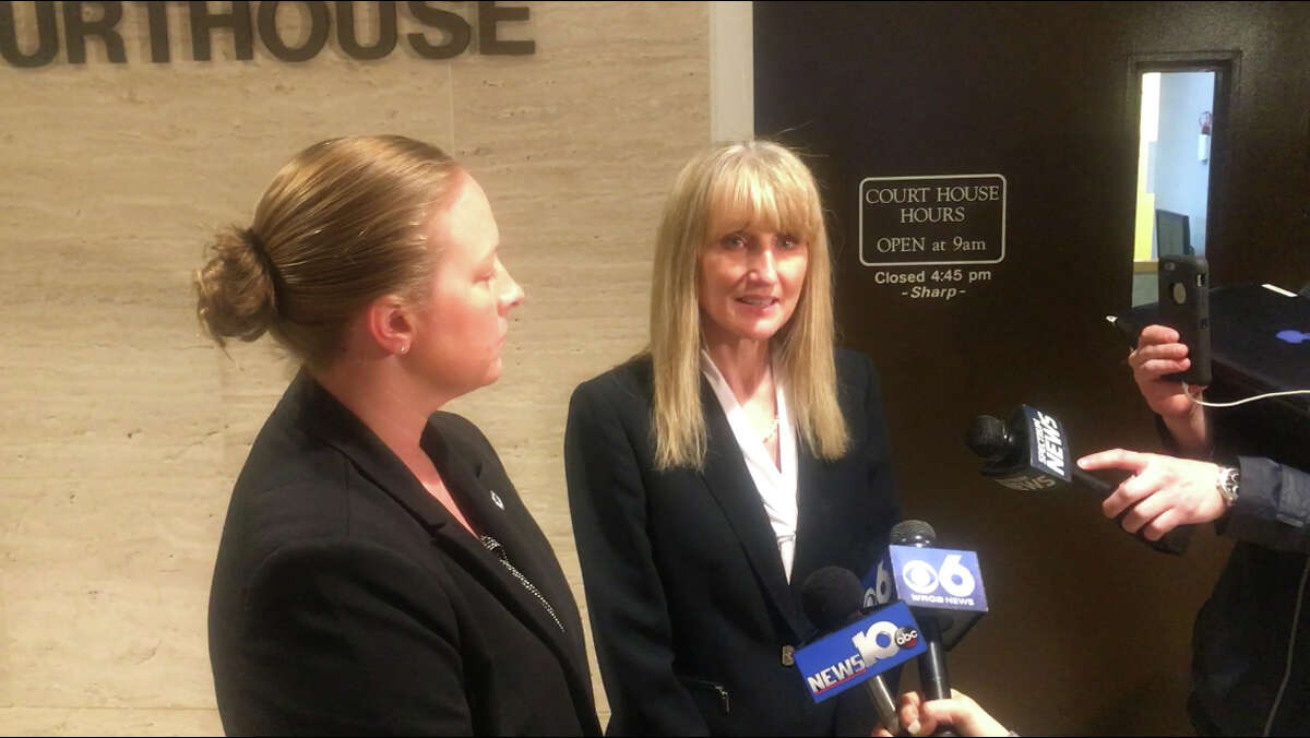 Schoharie County District Attorney Susan Mallery, right, talks with reporters on April 5, 2019, shortly after a grand jury indicted Nauman Hussain - the operator of the limousine company involved in the October 2018 crash - on 40 felony counts. Photographed with her is State Police Investigator Erika Hock. (Larry Rullison / Times Union)