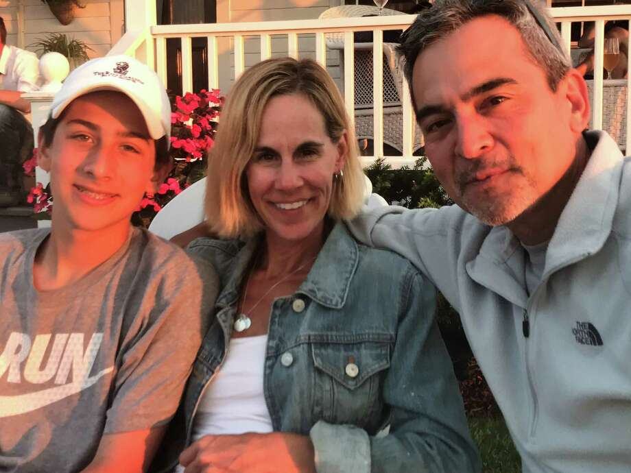 Ethan Song, who accidentally shot and killed himself at a friend's house in January 2018, is pictured with parents Kristin and Mike Song. Photo: Contributed Photo
