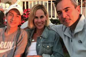 Ethan Song, the Guilford teen who died after he accidentally shot himself at a friend's house in January 2018, is pictured here with parents Kristin and Mike Song. The two became strong advocates of safe gun storage after their son's death.