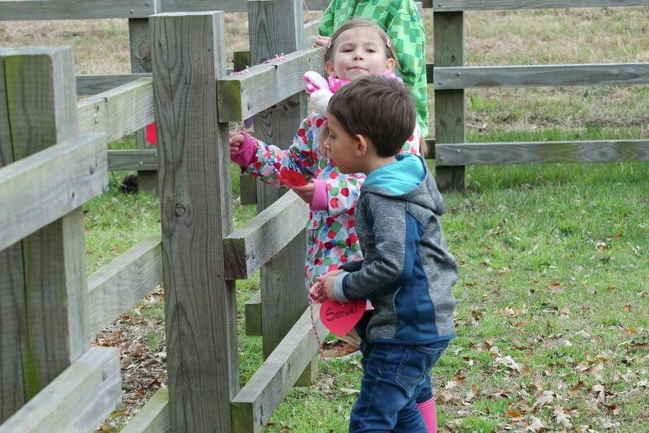 Scarlett Huffman and Samuel Pineros participate in an activity at a February event sponsored by Hike it Baby Galveston-Bay Area in League City. The group was founded by Scarlett's mom, Kristie. Photo: Kirk Sides / Staff Photographer / © 2018 Kirk Sides / Houston Chronicle