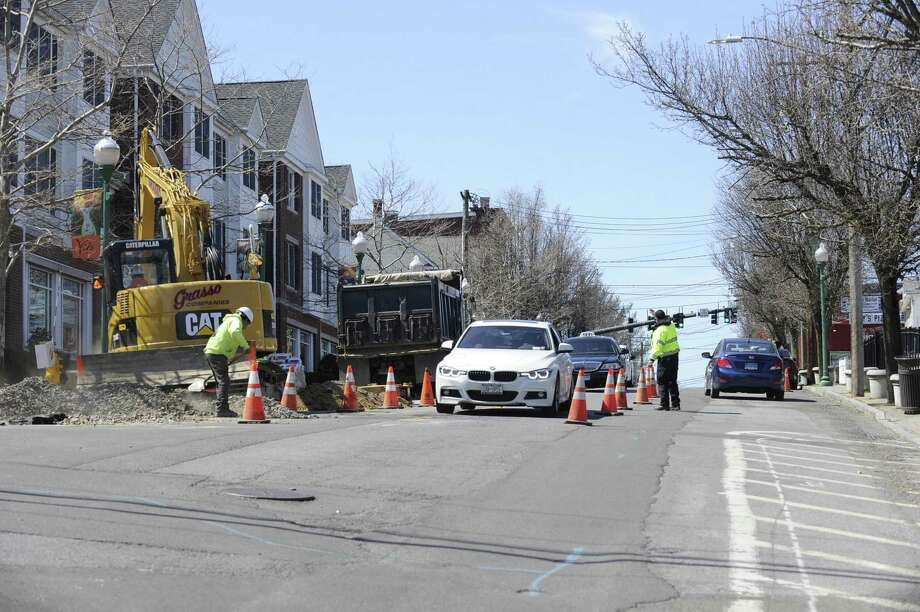 A construction crew works along Stillwater Avenue on Thursday, April 4, 2019 in Stamford, Connecticut. According to the City of Stamford's website, 11 streets are set to be paved this year with Stillwater listed among five streets that are slated to be re-paved in their entirety. Photo: Matthew Brown / Hearst Connecticut Media / Stamford Advocate