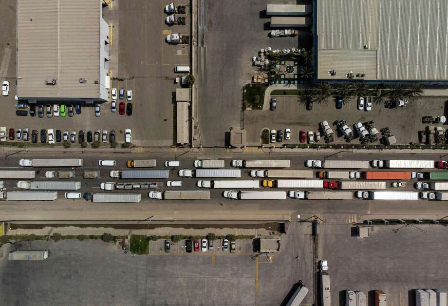 Aerial view of cargo trucks lining up to cross to the United States near the US-Mexico border at Otay Mesa crossing port in Tijuana, Baja California state, Mexico, on Tuesday. Trump's threat to close the U.S./Mexico border is meant to pressure Mexico to act on Central American migrants, but the solution really lies with Congress. Photo: GUILLERMO ARIAS /AFP /Getty Images / AFP or licensors