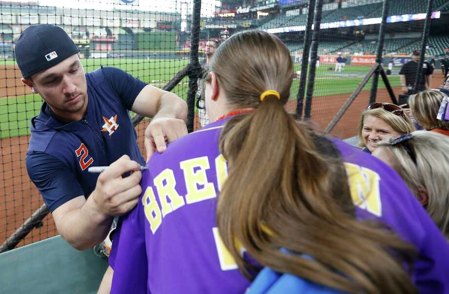 "PHOTOS: Best memes from the ""Old Town Road"" viral sensation Houston Astros third baseman Alex Bregman signs a jersey for a fan during the Houston Astros Opening Day Street Fest at Minute Maid Park, Friday, April 5, 2019, in Houston, before the start of their home opener against the Oakland A's. Photo: Karen Warren, Staff Photographer / © 2019 Houston Chronicle"