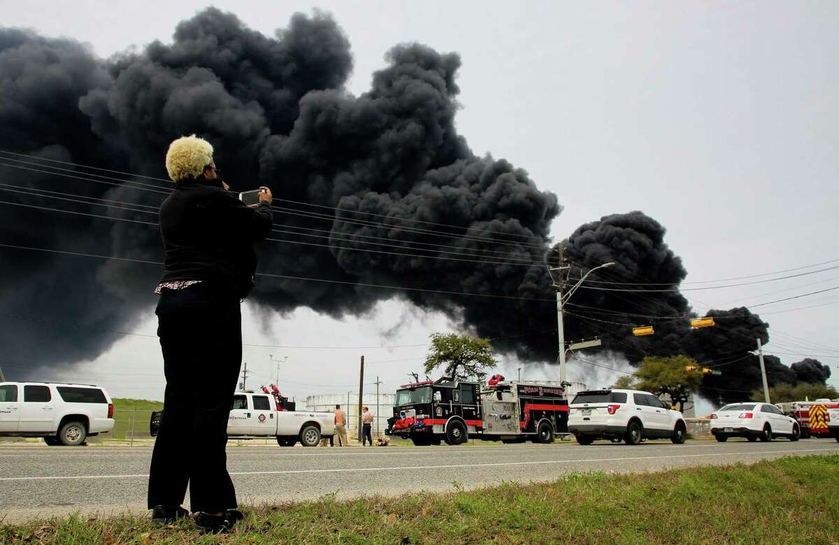 A plume of smoke rises in the air following a fire in March at the Intercontinental Terminals Co. petrochemical storage facility in Deer Park.