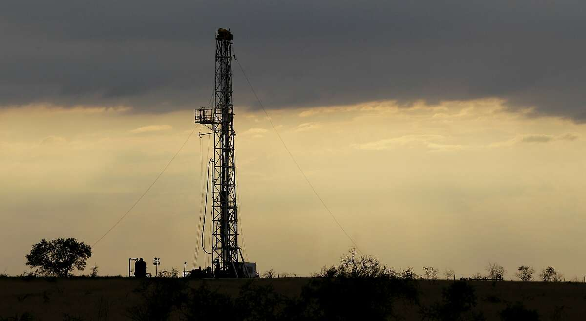 FILE -In this Wednesday, May 9, 2012, file photo, a drilling rig using horizontal drilling is seen near Kenedy, Texas.