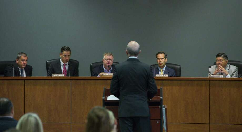 Texas' School Land Board controls how $10 billion of the state's $44 billion Permanent School Fund is invested. From right to left are board member Gilbert Burciaga, chairman George P.  Bush, board member Scott Rohrman, and staffers Mark Havens, deputy land commissioner and Jeff Gordon, general counsel. Photo: Mark Mulligan, Houston Chronicle / Staff Photographer / © 2018 Mark Mulligan / Houston Chronicle