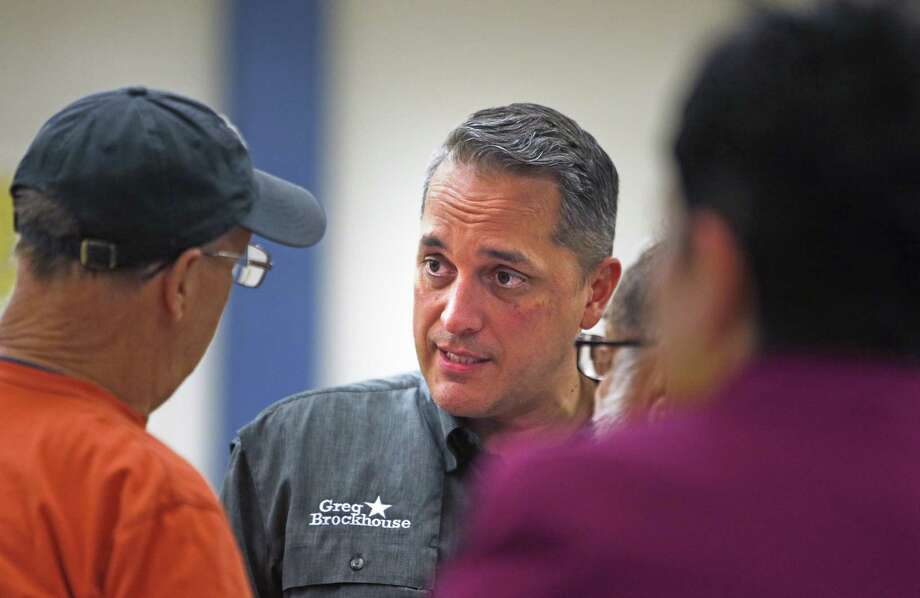 Greg Brockhouse listens to individuals after the mayoral forum at Highland Hill Elementary School on Monday. A police report on a domestic dispute involving the candidate is missing. The explanations on why are not adding up well. Photo: Ronald Cortes /Contributor / / 2019 Ronald Cortes