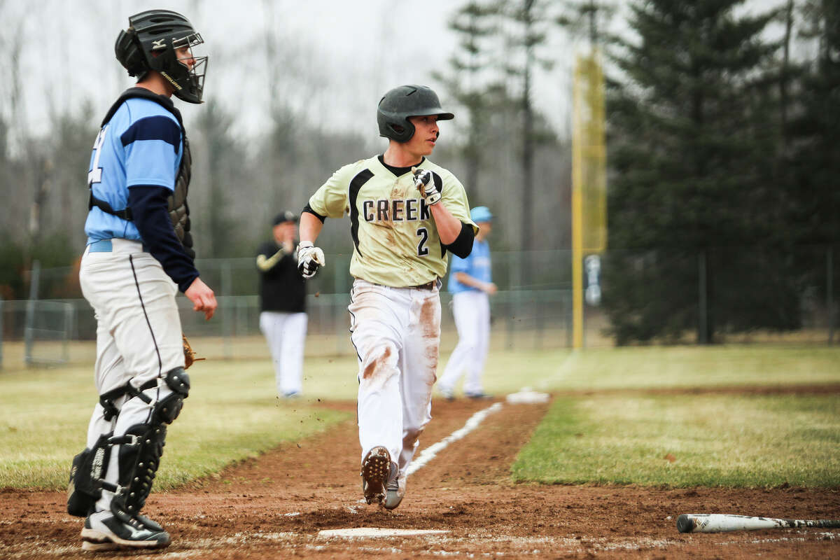 Bullock Creek's Caleb Buda sprints home to score a run during a game against Meridian on Friday, April 5, 2019 at Meridian Early College High School. (Katy Kildee/kkildee@mdn.net)