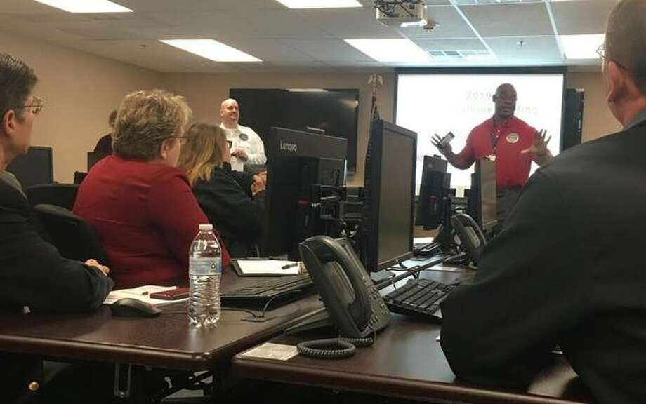 Madison County Emergency Management Agency Director Todd Fulton, standing center, and EMA Logistic Coordinator Tony Falconio, welcomed dozens of fire department, law enforcement, sanitary sewer and levee district, public works, county and elected officials, to a flood outlook briefing this week in Wood River. Photo: Photo Courtesy Of Cynthia Ellis