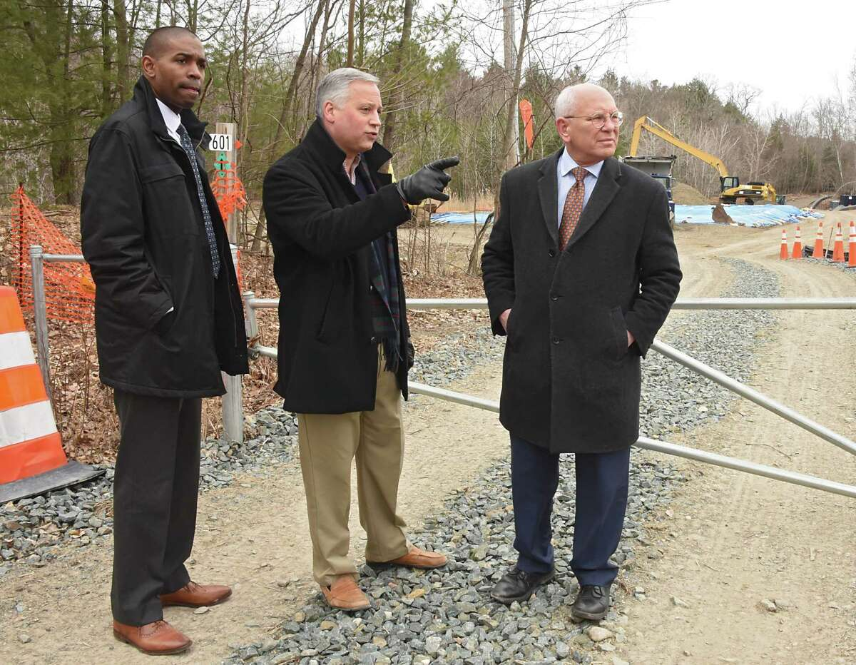 From left, Congressman Antonio Delgado, Nassau Town Supervisor David Flemming, and Congressman Paul Tonko look at the Dewey Loeffel superfund site on Friday April 5, 2019 in Nassau, N.Y. Federal investigators found PCBs, carcinogenic industrial solvents and other chemicals contaminating the family property of Dewey Loeffel, who ran the landfill during the 1950s and '60s that still leaks dangerous toxins. (Lori Van Buren/Times Union)