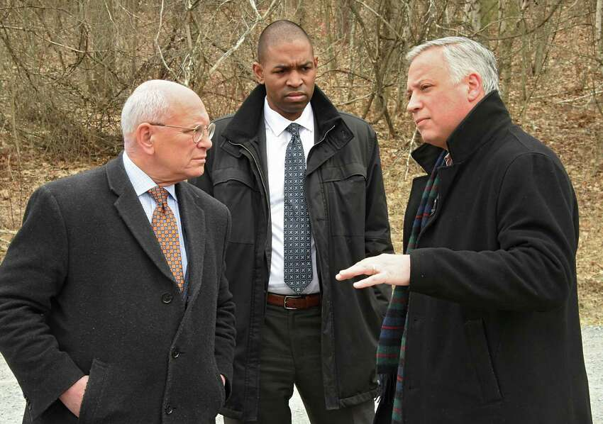 From left, Congressman Paul Tonko, Congressman Antonio Delgado, and Nassau Town Supervisor David Flemming speak outside the Dewey Loeffel superfund site on Friday April 5, 2019 in Nassau, N.Y. Federal investigators found PCBs, carcinogenic industrial solvents and other chemicals contaminating the family property of Dewey Loeffel, who ran the landfill during the 1950s and '60s that still leaks dangerous toxins. (Lori Van Buren/Times Union)