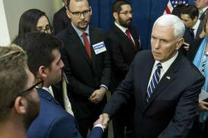 Vice President Mike Pence greets displaced Venezuelans before speaking on the crisis in Venezuela at Rice University's Baker Institute for Public Policy on Friday, April 5, 2019, in Houston.
