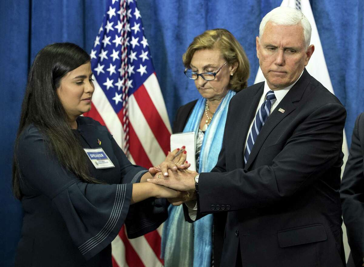 Vice President Mike Pence shakes hands with activist Christina Bastidas as he greets a group of displaced Venezuelans before giving a speech on the crisis in the South American country at Rice University's Baker Institute for Public Policy on Friday, April 5, 2019, in Houston.