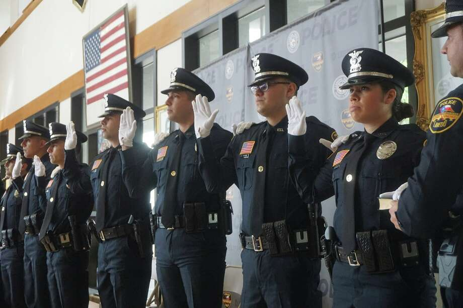 In this file photo, Laredo police swear in six men and one woman into their ranks during a pinning of the badge ceremony. Photo: Laredo Police Department