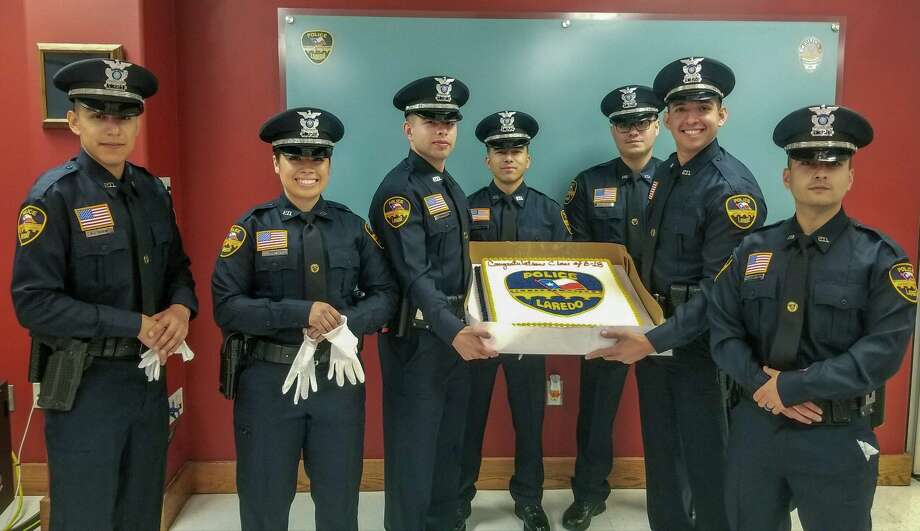 Laredo police sworn in six men and one woman into their ranks on Friday morning during a pinning of the badge ceremony. Photo: Laredo Police Department