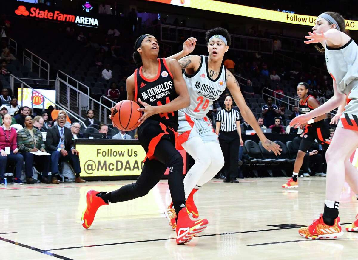 Aubrey Griffin drives against Kierstan Bell during the 2019 McDonald's High School Girls All-American Game on March 27, 2019 at State Farm Arena in Atlanta.