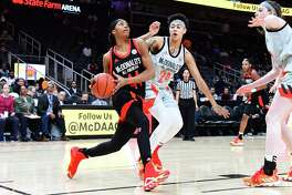 UConn-commit Aubrey Griffin (44) of Ossining, N.Y. drives against Kierstan Bell of Canton, Ohio during the 2019 McDonald's High School Girls All-American Game on March 27 at State Farm Arena in Atlanta.