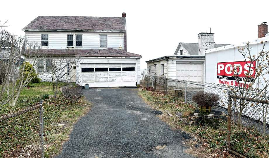 Properties at 110, left, and 114 Morgan Ave. in East Haven Photo: Arnold Gold / Hearst Connecticut Media / New Haven Register