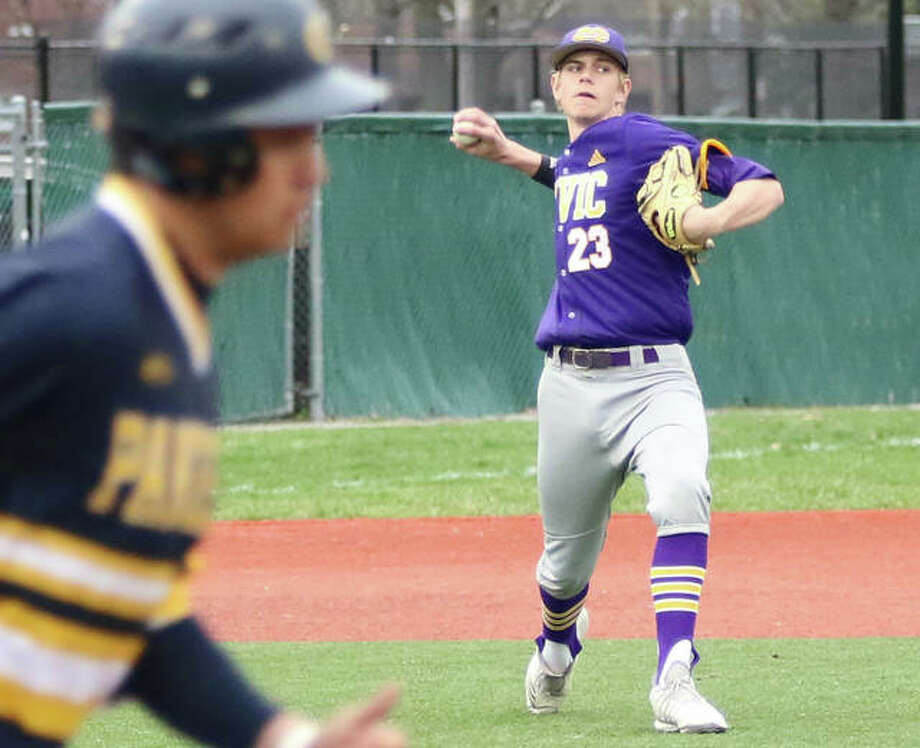 CM third baseman Eli Smock (right) fires to first to throw out an O'Fallon hitter Friday at Blazier Field in O'Fallon. Photo: Greg Shashack / The Telegraph