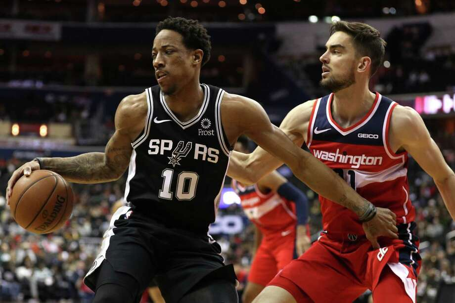 WASHINGTON, DC - APRIL 05: DeMar DeRozan #10 of the San Antonio Spurs dribbles in front of Tomas Satoransky #31 of the Washington Wizards during the first half at Capital One Arena on April 05, 2019 in Washington, DC. NOTE TO USER: User expressly acknowledges and agrees that, by downloading and or using this photograph, User is consenting to the terms and conditions of the Getty Images License Agreement. Photo: Patrick Smith, Getty Images / 2019 Getty Images