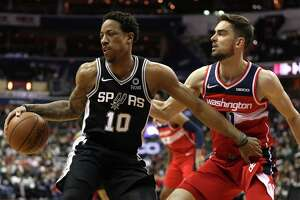 WASHINGTON, DC - APRIL 05: DeMar DeRozan #10 of the San Antonio Spurs dribbles in front of Tomas Satoransky #31 of the Washington Wizards during the first half at Capital One Arena on April 05, 2019 in Washington, DC. NOTE TO USER: User expressly acknowledges and agrees that, by downloading and or using this photograph, User is consenting to the terms and conditions of the Getty Images License Agreement.