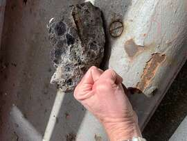 A chunk of concrete that spalled from the upper deck of the Richmond-San Rafael Bridge.