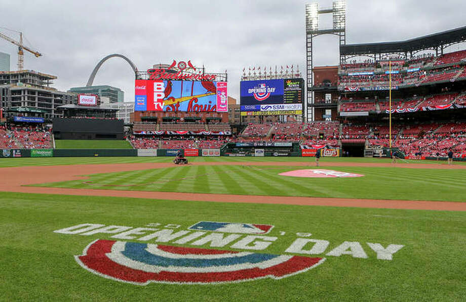 Grounds crew members prepare the field at Busch Stadium for the Cardinals' home-opener against the San Diego Padres on Friday in St. Louis. Photo: Scott Kane / Associated Press