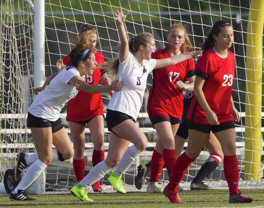 The Woodlands midfielder Grace Henderson (23) turns away as Round Rock forward Sydnie Myers (3) celebrates her goal during a Region II-6A quarterfinals match Friday. Photo: Jason Fochtman, Houston Chronicle / Staff Photographer / © 2019 Houston Chronicle