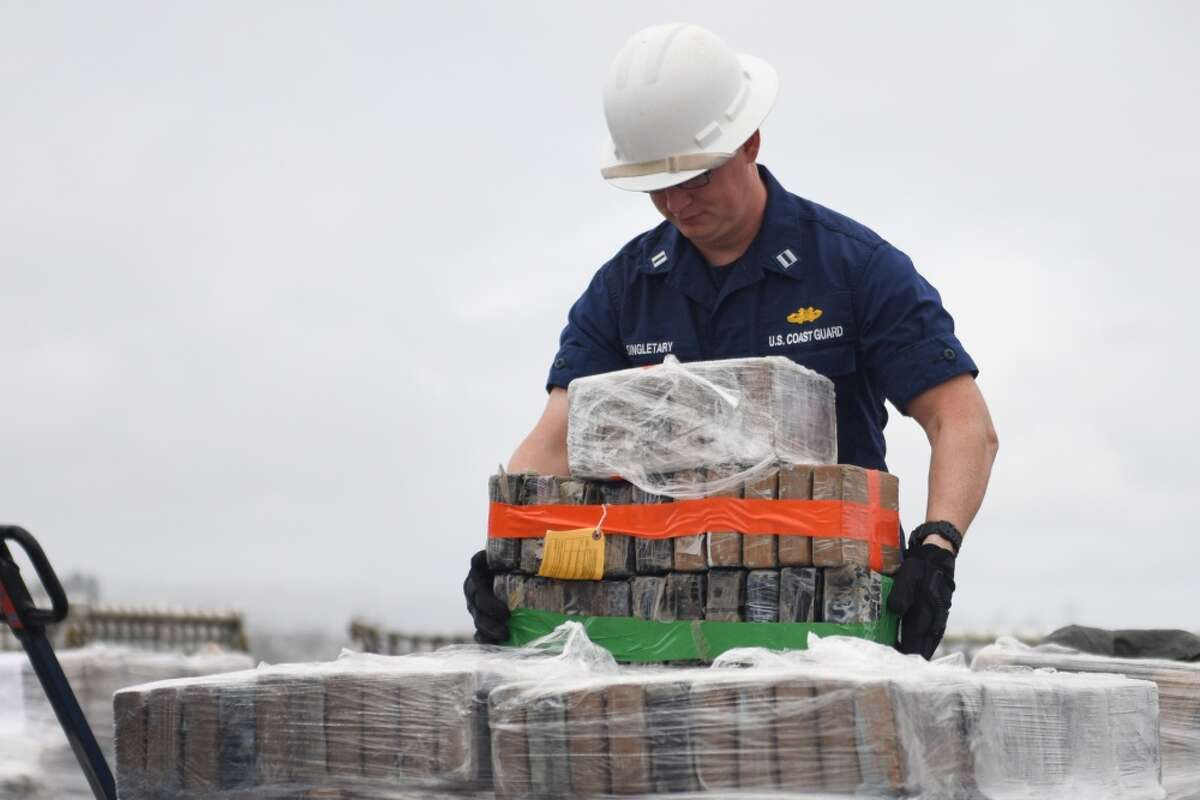 Lt. William Singletary, a commissioned officer aboard Coast Guard Cutter Waesche, offloads contraband from the cutter at Tenth Avenue Marine Terminal in San Diego April 5, 2019. More than 7.1 tons of cocaine were seized during six separate interdictions off the coasts of Mexico, Central and South America by the Coast Guard cutters Active (WMEC-618), Steadfast (WMEC-623) and Waesche (WMSL-751).