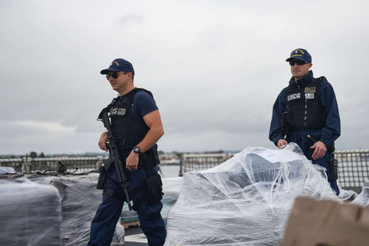 Petty Officer 2nd Class Raymond Hayden, a machinery technician aboard Coast Guard Cutter Waesche, and Petty Officer 2nd Class Daniel Russo, a boatswain's mate aboard Waesche, secure the deck of the cutter Friday prior to the crew offloading more than 7.1 tons of contraband at Tenth Avenue Marine Terminal in San Diego April 5, 2019. The drugs were seized during six separate interdictions off the coasts of Mexico, Central and South America by the Coast Guard cutters Active (WMEC-618), Steadfast (WMEC-623) and Waesche (WMSL-751).