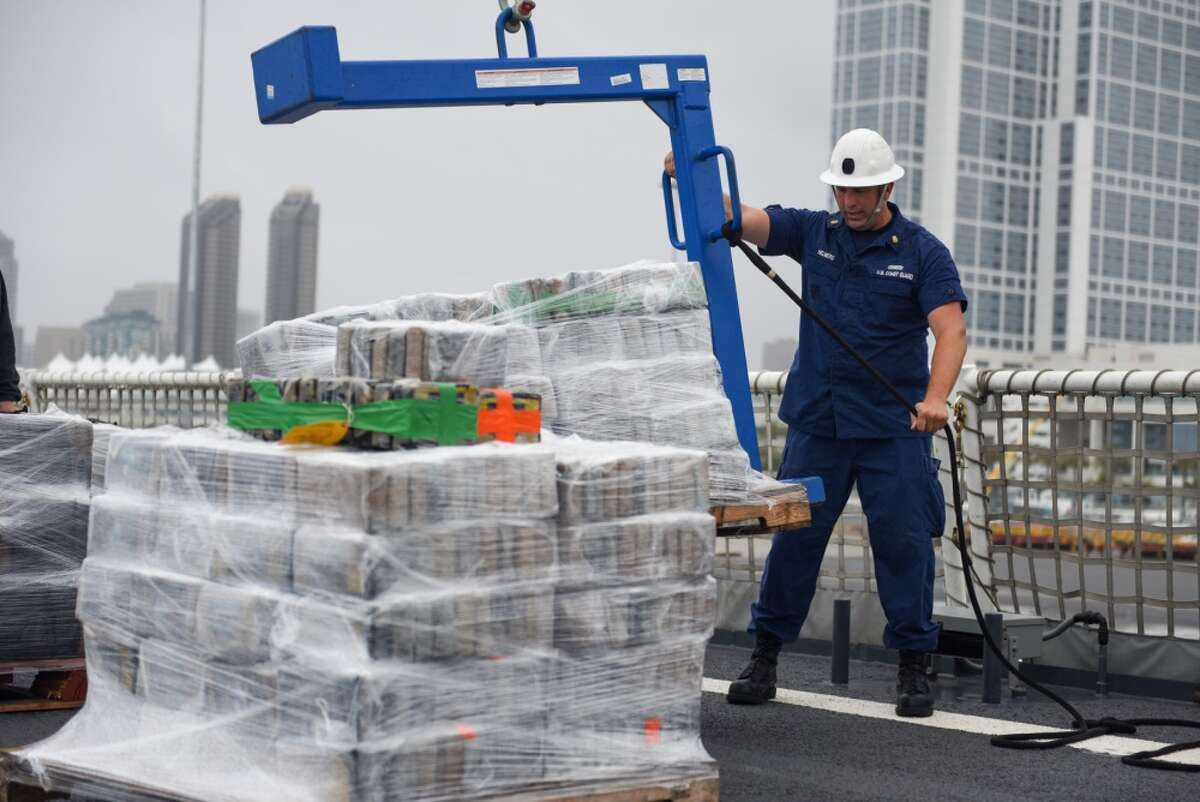 Petty Officer 1st Class Gregory Helmers, a boatswain's mate aboard Coast Guard Cutter Waesche, offloads contraband from the cutter at Tenth Avenue Marine Terminal in San Diego April 5, 2019. More than 7.1 tons of cocaine were seized during six separate interdictions off the coasts of Mexico, Central and South America by the Coast Guard cutters Active (WMEC-618), Steadfast (WMEC-623) and Waesche (WMSL-751).