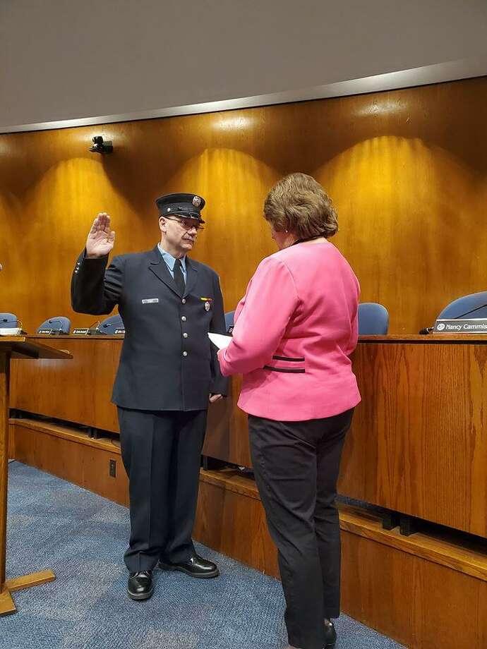 Tim Smith swearing in as Danbury's newest deputy fire marshal. Photo: Mayor Mark Boughton / Facebook