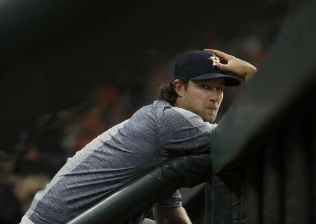 Houston Astros pitcher Gerrit Cole in the dugout during the fourth inning of the Houston Astros home opener at Minute Maid Park, Friday, April 5, 2019, in Houston.