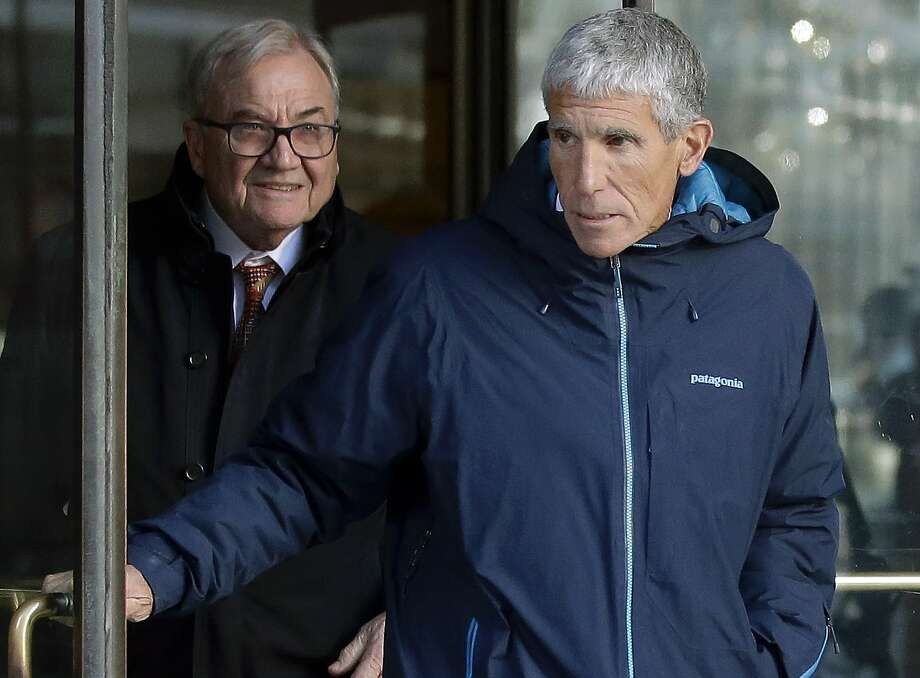 "In this March 12, 2019 photo, William ""Rick"" Singer, front, founder of the Edge College & Career Network, exits federal court in Boston after he pleaded guilty to charges in a nationwide college admissions bribery scandal, where ringers were hired to take SAT tests and proctors paid to look the other way. The scandal is fueling deeper concerns about the fairness of using SAT and ACT tests to determine college admission. (AP Photo/Steven Senne) Photo: Steven Senne / Associated Press"