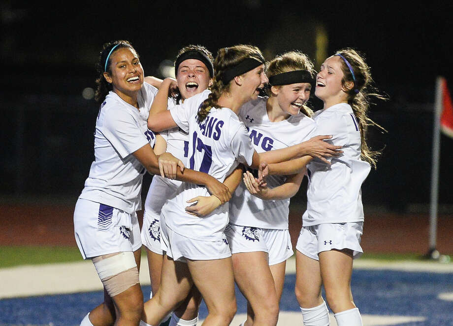 PN-G players celebrate after Kelsie Comeaux scored the first point of the game deep in the second half during the game against Texas City at Barbers Hill Friday night. Photo taken on Friday. Ryan Welch/The Enterprise Photo: Ryan Welch, The Enterprise / ©Ryan Welch