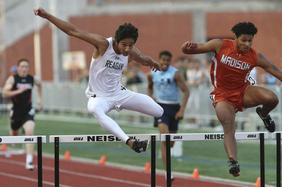 Reagan's Noah Crawford (left) and Madison's Dante Heaggans leap for the finish in the 300-meter hurdles at the District 27-6A track meet at Heroes Stadium on Friday, Apr. 5, 2019. (Kin Man Hui/San Antonio Express-News) Photo: Kin Man Hui, Staff / Staff Photographer / ©2019 San Antonio Express-News