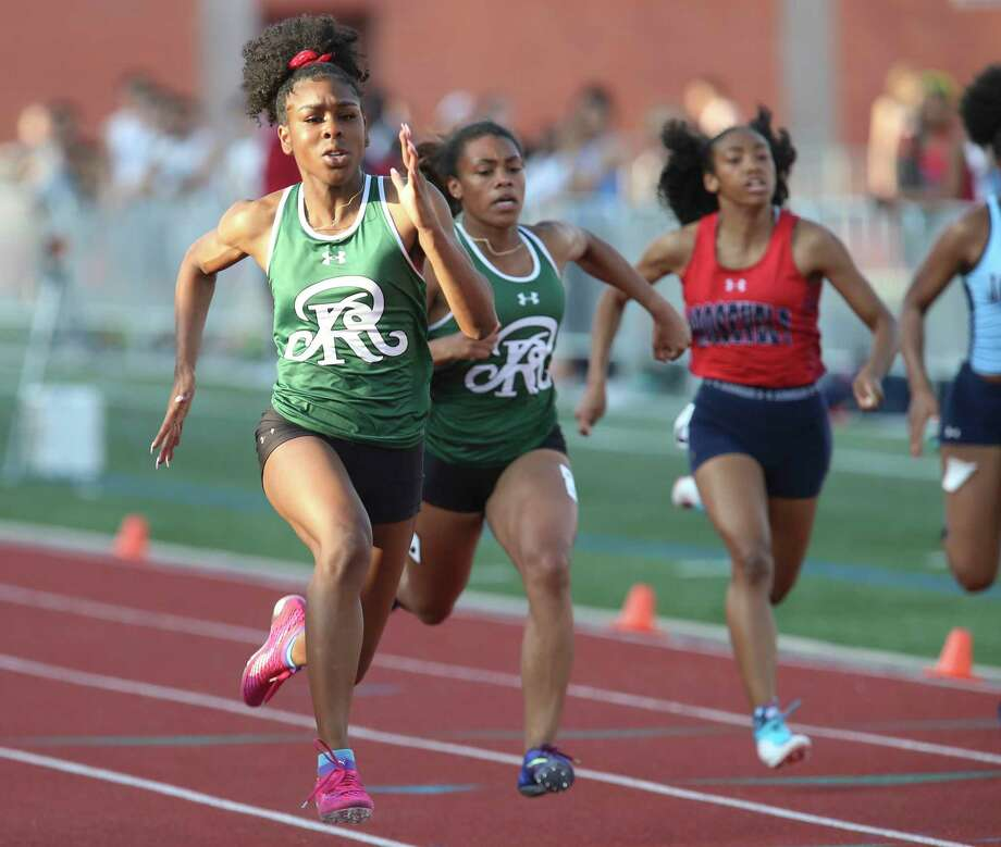 Reagan's Jasmine Montgomery (left) pulls ahead to finish first in the 100-meter dash at the District 27-6A track meet at Heroes Stadium on Friday, Apr. 5, 2019. (Kin Man Hui/San Antonio Express-News) Photo: Kin Man Hui, Staff / Staff Photographer / ©2019 San Antonio Express-News