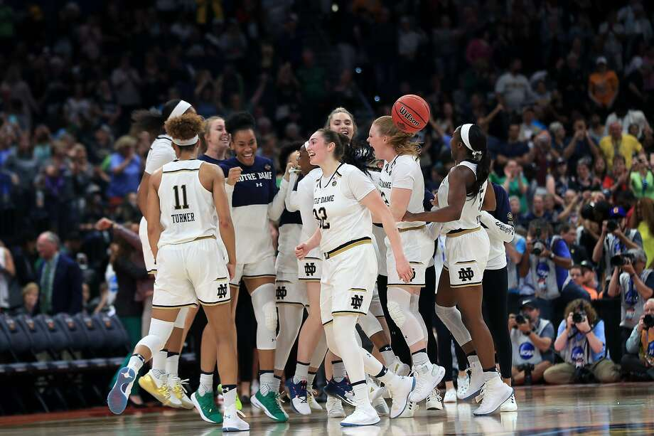 TAMPA, FLORIDA - APRIL 05:  The Notre Dame Fighting Irish celebrate their 81-76 win over the UConn Huskies in the semifinals of the 2019 NCAA Women's Final Four at Amalie Arena on April 05, 2019 in Tampa, Florida. (Photo by Mike Ehrmann/Getty Images) Photo: Mike Ehrmann, Getty Images