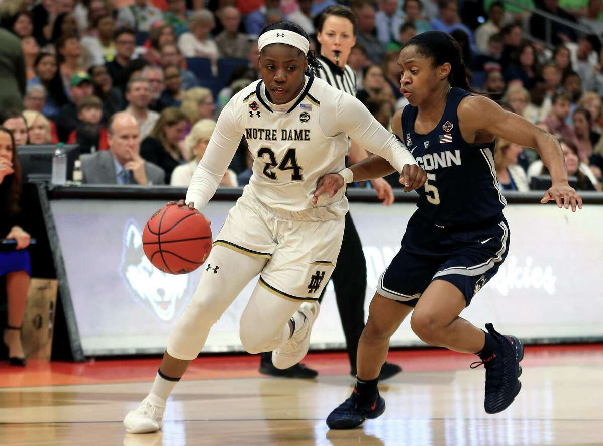 Notre Dame's Arike Ogunbowale is defended by UConn's Crystal Dangerfield during the second quarter in the semifinals of the Final Four at Amalie Arena on April 5 in Tampa, Florida.