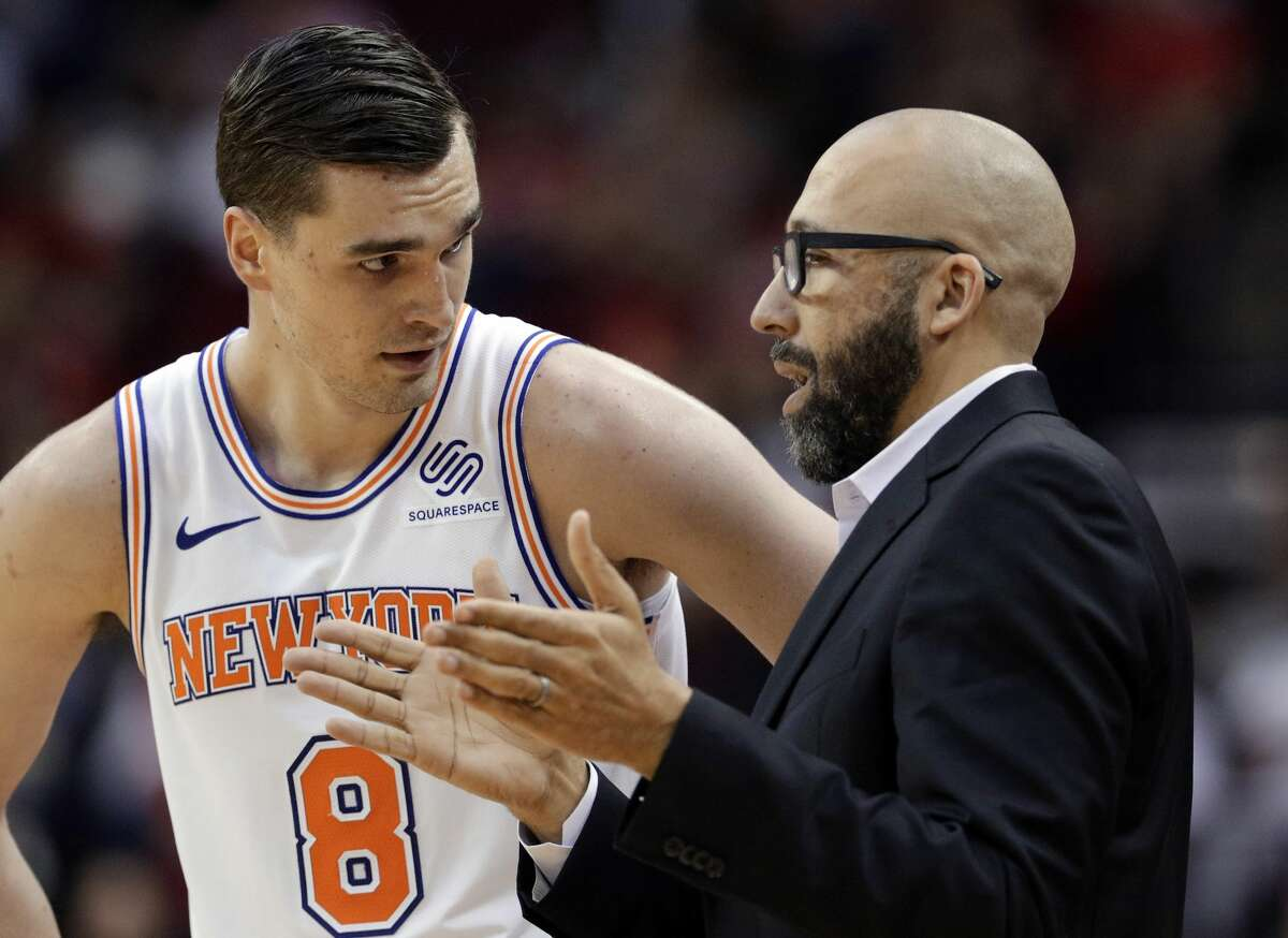 New York Knicks forward Mario Hezonja (8) and coach David Fizdale talk between plays during the second half of the team's NBA basketball game against the Houston Rockets on Friday, April 5, 2019, in Houston. (AP Photo/Michael Wyke)