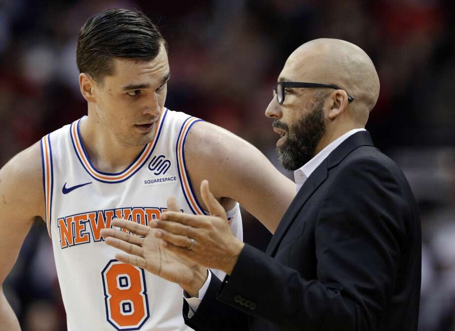 New York Knicks forward Mario Hezonja (8) and coach David Fizdale talk between plays during the second half of the team's NBA basketball game against the Houston Rockets on Friday, April 5, 2019, in Houston. (AP Photo/Michael Wyke) Photo: Michael Wyke/Associated Press