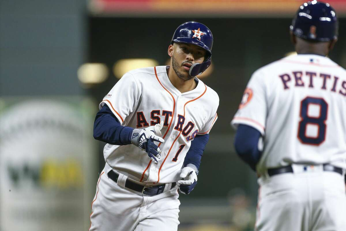 Houston Astros shortstop Carlos Correa (1) heads to home plate after hitting a home run against the Oakland Athletics during the fourth inning of an MLB game at Minute Maid Park Friday, April 5, 2019, in Houston.