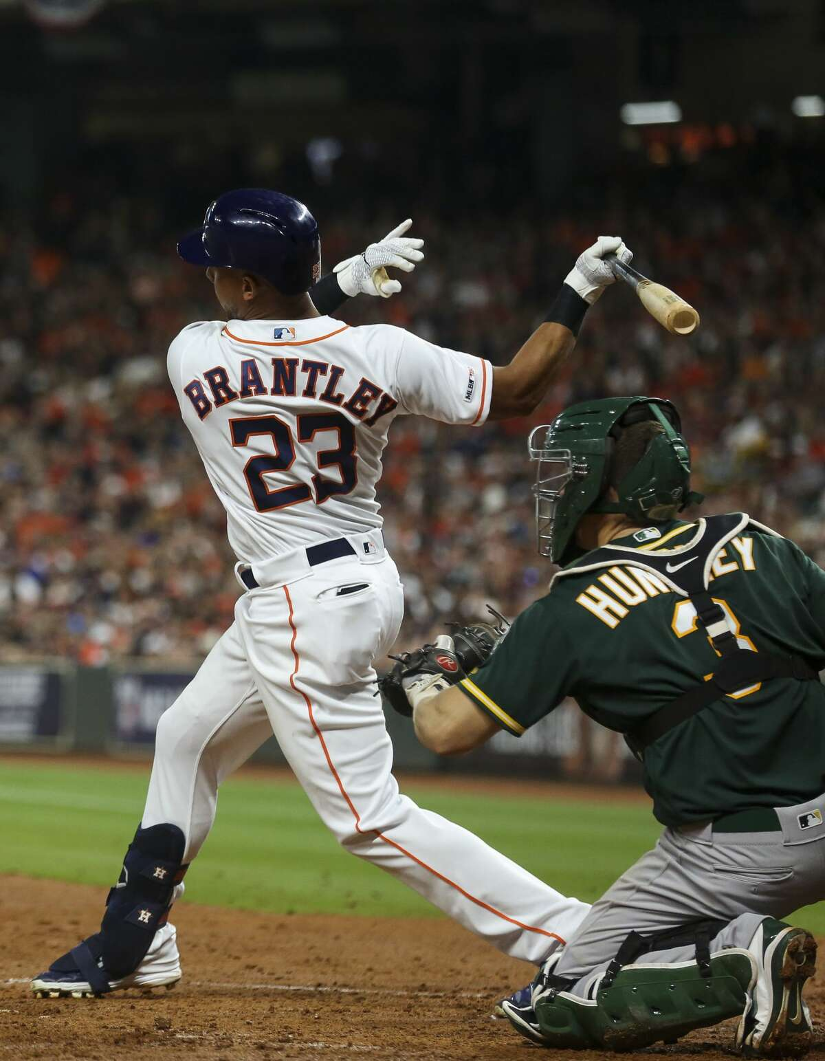 Houston Astros left fielder Michael Brantley (23) strikes out to end the third inning against the Oakland Athletics of an MLB game at Minute Maid Park Friday, April 5, 2019, in Houston.