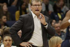 Connecticut head coach Geno Auriemma gestures to his team during the first half of a women's Final Four NCAA college basketball semifinal tournament game against Notre Dame, Friday, April 5, 2019, in Tampa, Fla. (AP Photo/Chris O'Meara)