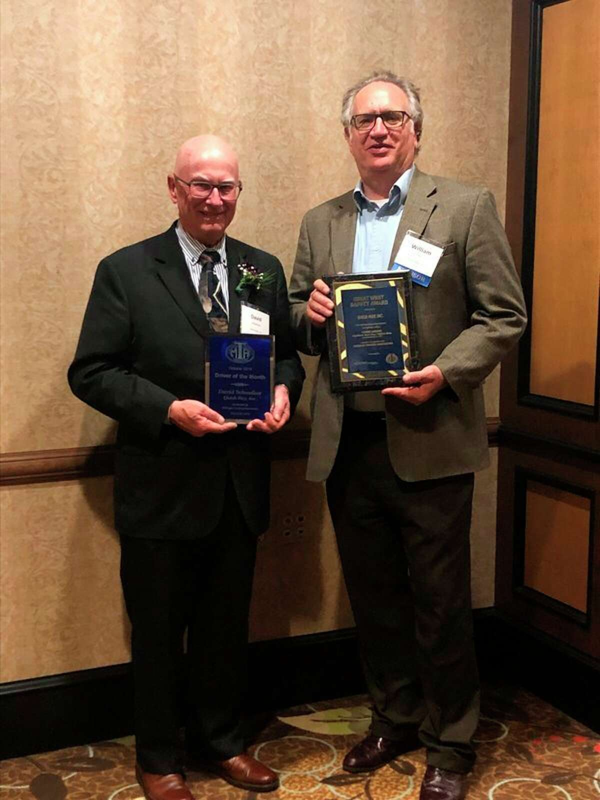David Schmelzer,left, and William 'Bill' Dunn ofQuick-Way, Inc.accept awards from theMichigan Trucking Association. (Photo provided/Quick-Way)