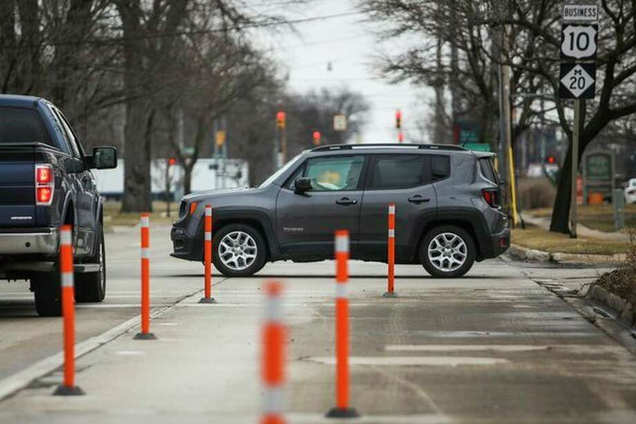 Drivers travel along Buttles Street on Friday in Midland. (Katy Kildee/kkildee@mdn.net)