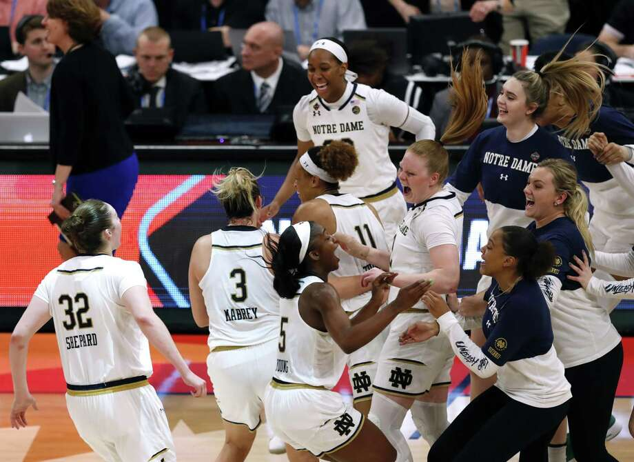 Notre Dame players celebrate after defeating Connecticut 81-76 during a Final Four semifinal of the NCAA women's college basketball tournament Friday, April 5, 2019, in Tampa, Fla. Photo: Mark LoMoglio / Associated Press / Copyright 2019 The Associated Press. All rights reserved
