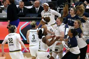 Notre Dame players celebrate after defeating Connecticut 81-76 during a Final Four semifinal of the NCAA women's college basketball tournament Friday, April 5, 2019, in Tampa, Fla.