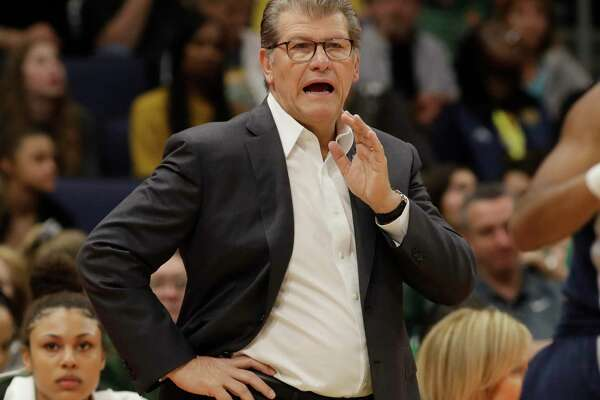 UConn head coach Geno Auriemma gestures to his team during a Final Four semifinal game against Notre Dame on April 5 in Tampa, Fla.