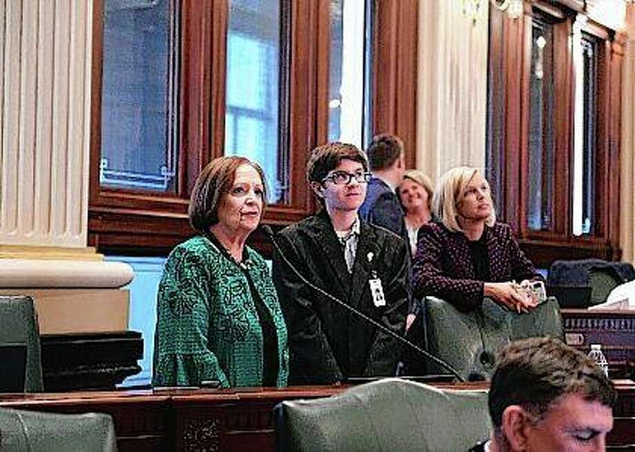 Ben Werner of Virginia (center) is introduced by Assistant House Minority Leader Norine K. Hammond, R-Macomb, in the Illinois House of Representatives. Werner was Hammond's page for the day and was able to see the legislative process in action. Photo: Photo Provided